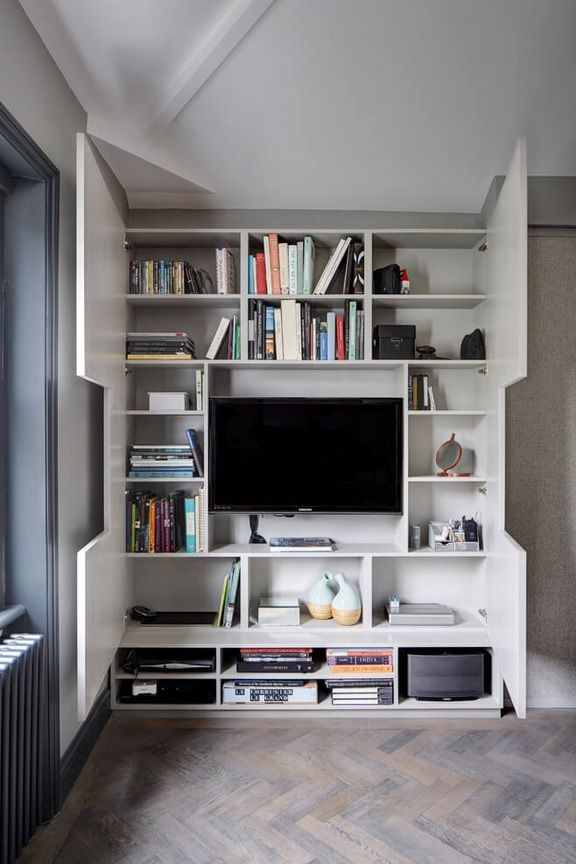 London Apartment Loft Style Interior Design. Nice cozy TV Cabinet with plenty of personal things unfolded
