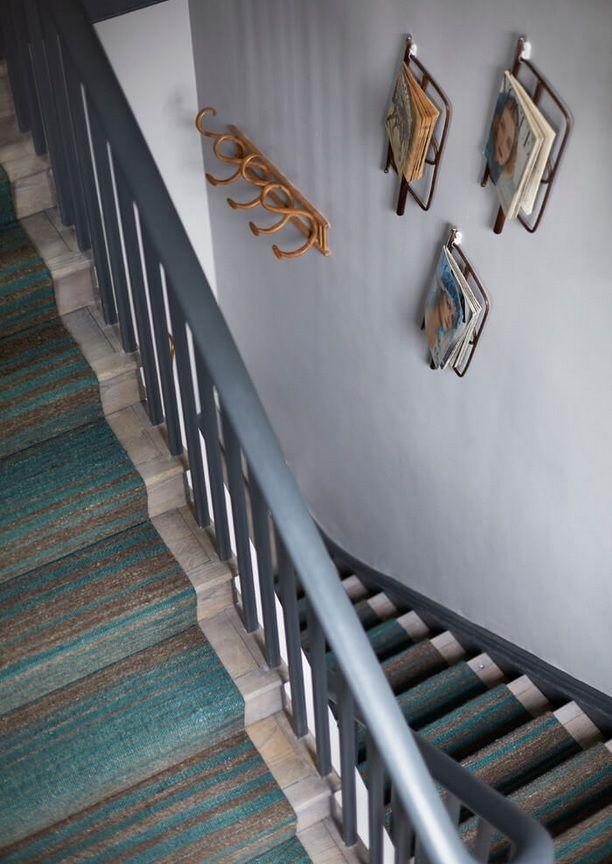 London Apartment Loft Style Interior Design. Stairs and the hanged journals
