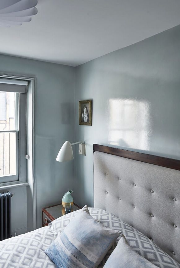 London Apartment Loft Style Interior Design. Bedroom with classic upholstered headboard