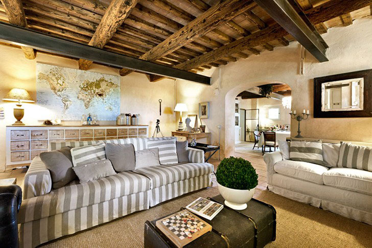 Typical Mediterranean style living room with exposed wooden ceiling beams