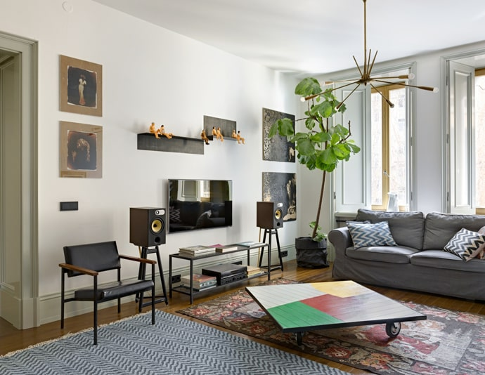White colored walls and plenty of minimalistic furniture to complement interesting ecological living room interior