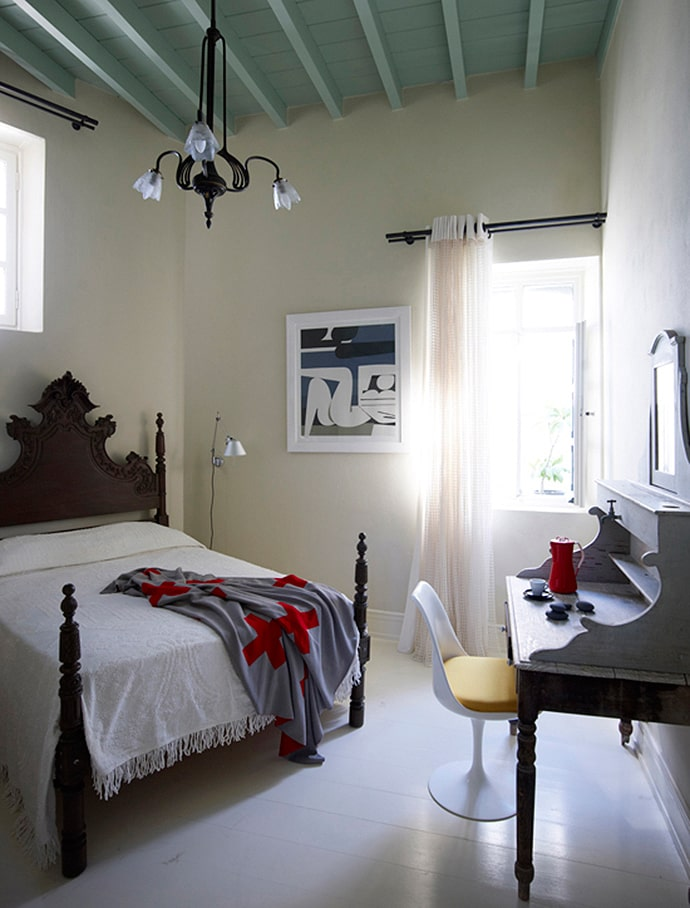 King size bed and pastel colored walls for Mediterranean styled bedroom