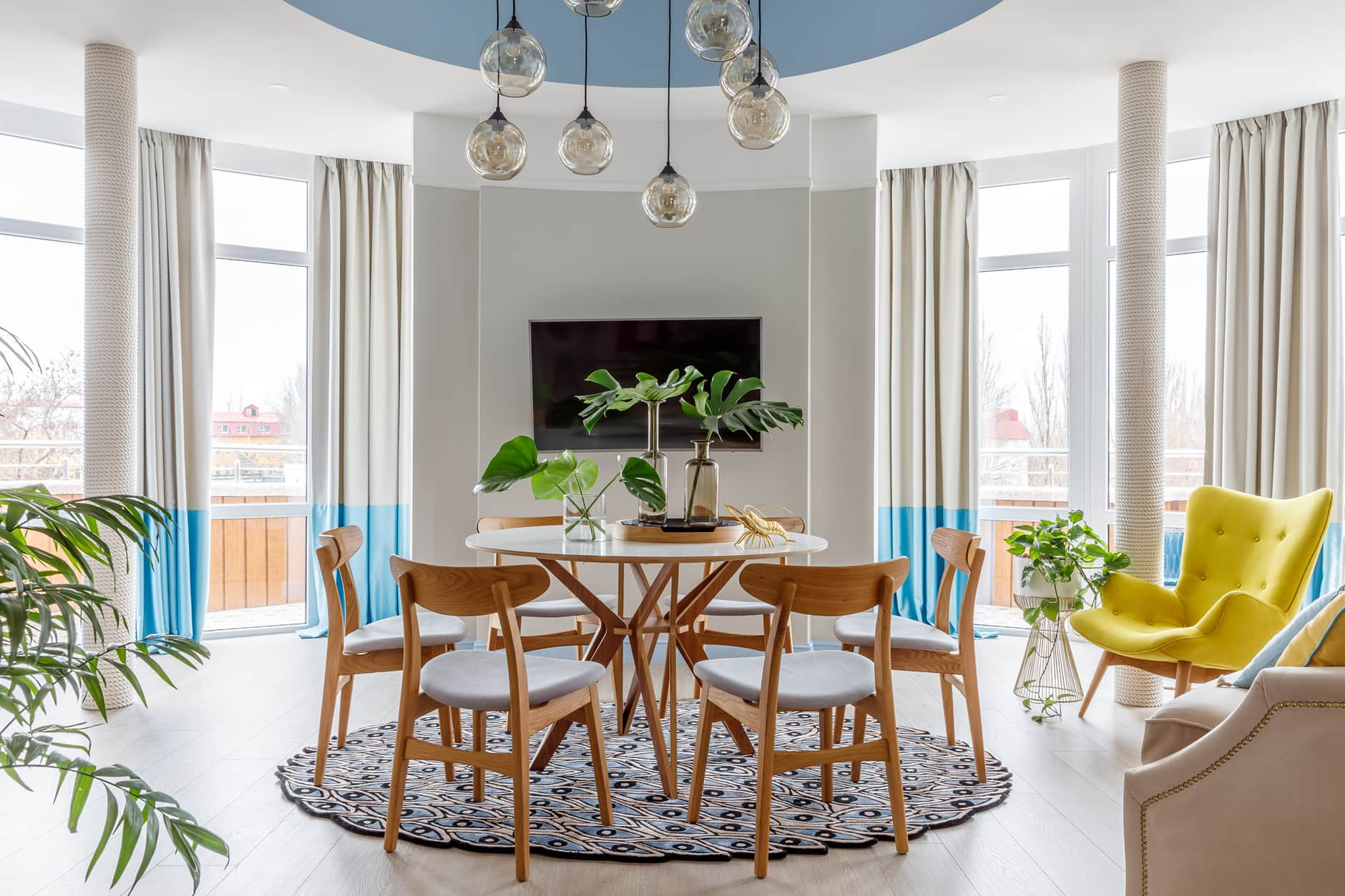 Round dining zone with wooden furniture for fresh and prominent Mediterranean room