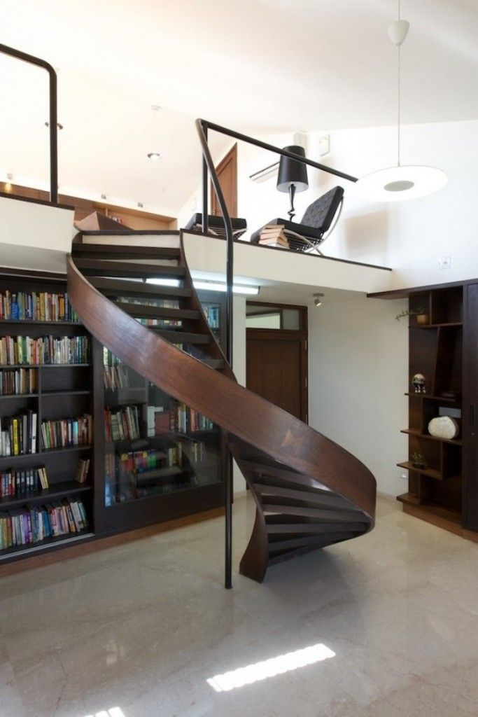 Interior Staircase Original Design Ideas. Semi-spiral wavy wooden stairs without handrails leading down to the library