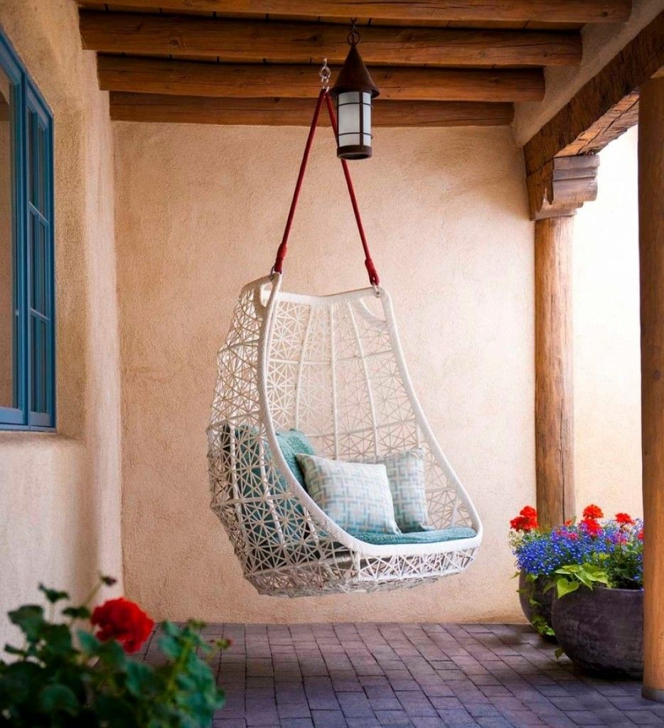 Mediterranean Interior Design Style. Swing chair on the red rope in the creamy wall surrounding