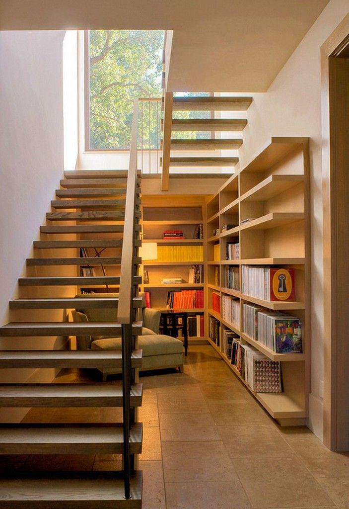 Staircase Modern Constructions Types Design. Library area under the wooden two-run stairway