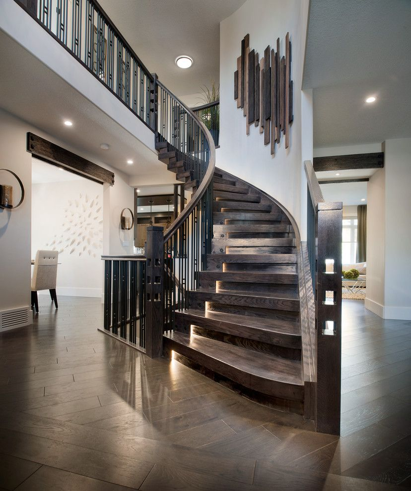 Modern Interior Staircase Materials Photo. Chic private house dark wooden interior in classic style with curved stairwell without risers