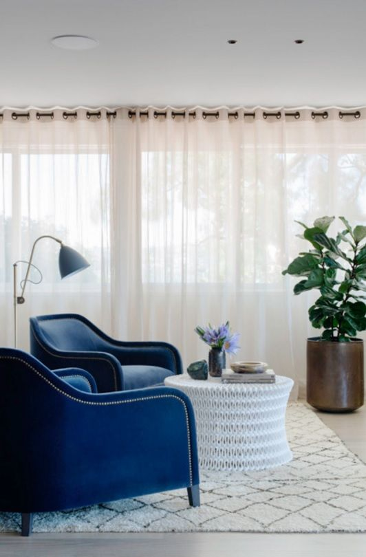 Australian Ocean Shore Private House Design Review. Blue riveted gold armchairs create special relaxing atmosphere in the spacious living