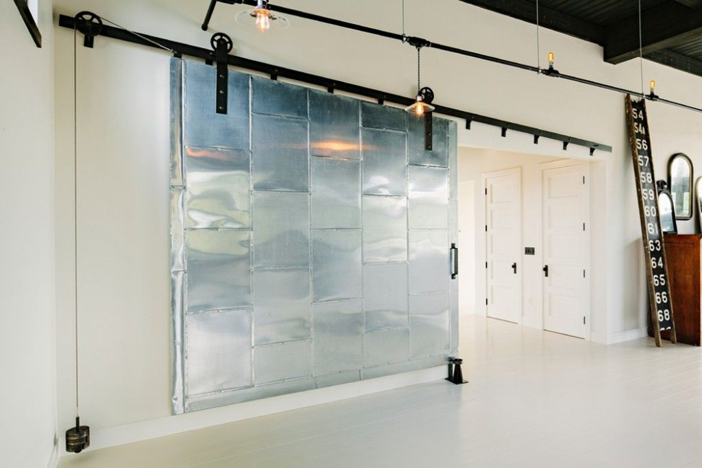sliding doors interior design ideas. Huge folding loft style gates in the large apartment