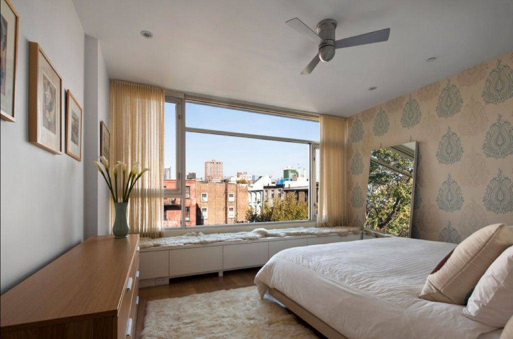 Bedroom Interior Furniture Set Programme Ideas. Panoramic window with the typical urban landscape and the functional city styled room