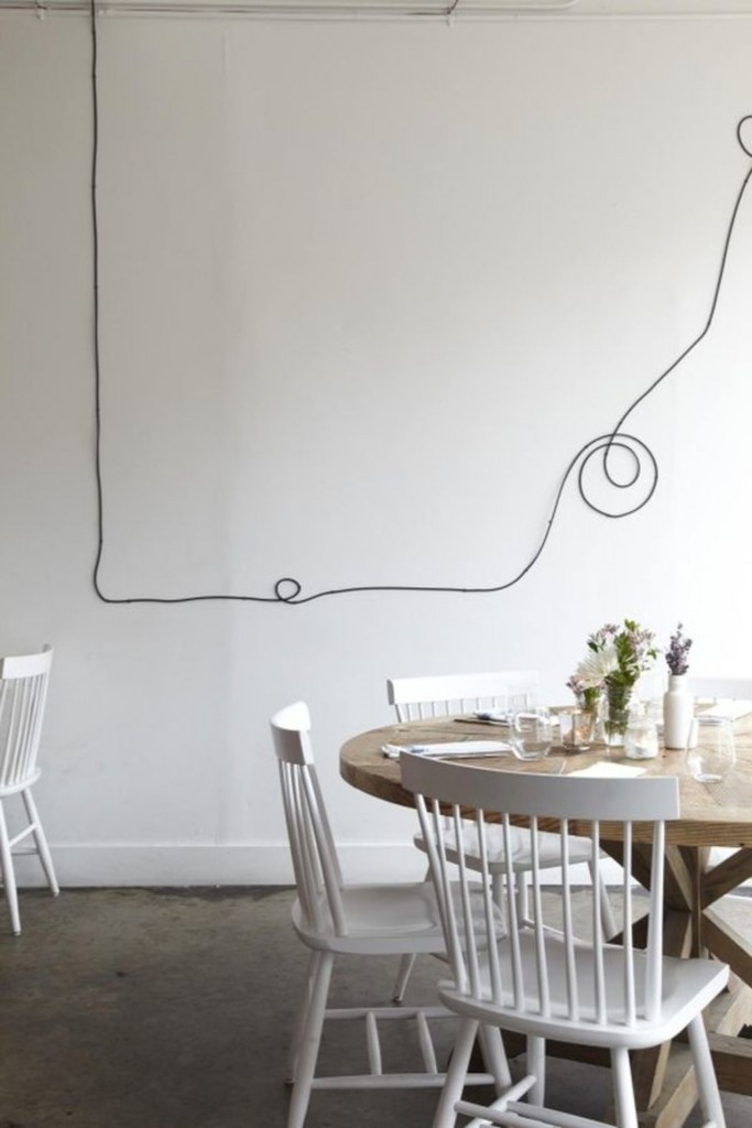 Wires and Cords as Interior Decorating Ideas. Strange picture on the wall is still interesting