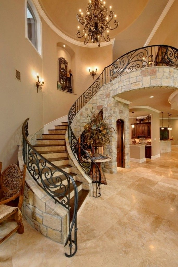 Staircase Modern Constructions Types Design. Royal curved concrete made stairway with wrought iron handrails and decorativу granite finishing of the stringer