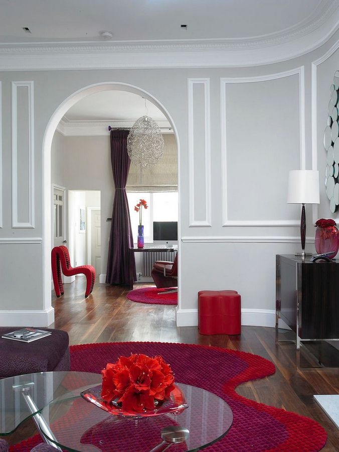 Interior Room Arches Decoration Ideas. Unusual red upholstered furniture continues the smooth forms of the architectural ideas