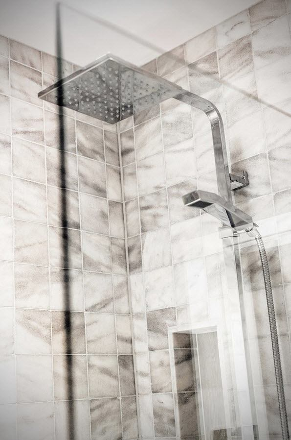Scottish Apartment Unusual Country Interior Design. Multifunctional bath cabin with dark gray marble streaks on the tiles