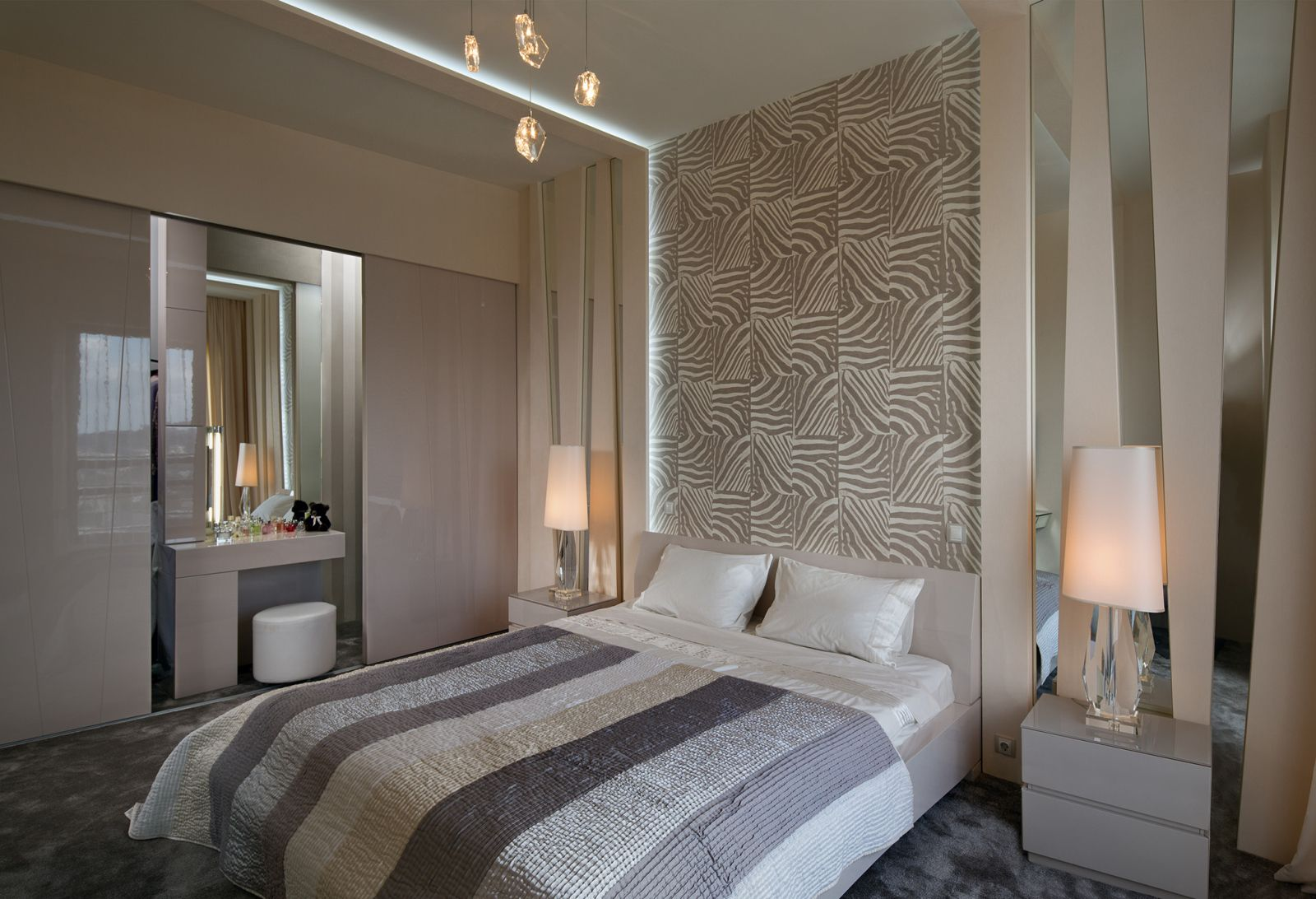 Interior Design Styles Combination in Modern Ukrainian Apartment. Bedroom with bedside tables and soft tiled headboard and boudoir