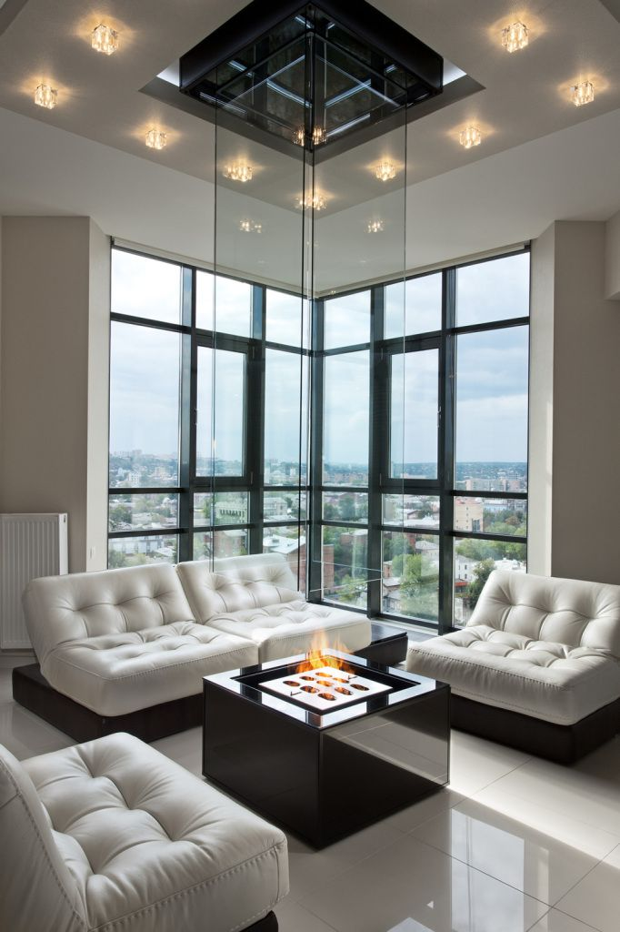 Interior Design Styles Combination in Modern Ukrainian Apartment. Hearth and the bay window to the midtown of the big city