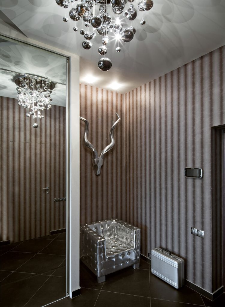 Interior Design Styles Combination in Modern Ukrainian Apartment. Hall with mirror closet and the dummy of the buffalo.