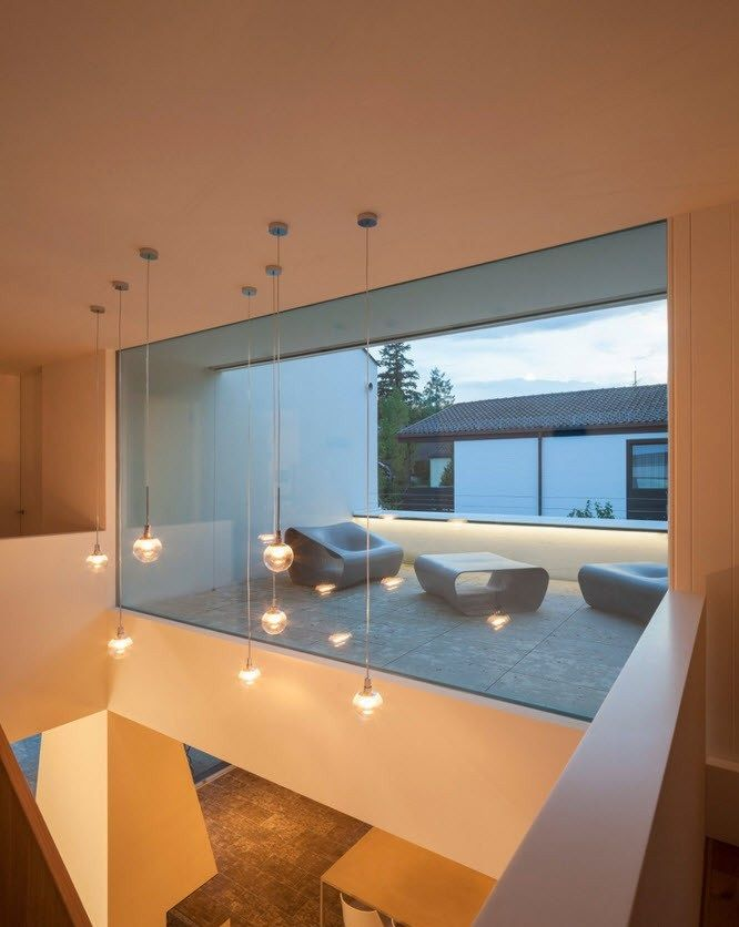 German Minimalistic House Brief Overview. Spectacular view on the second floor in the evening