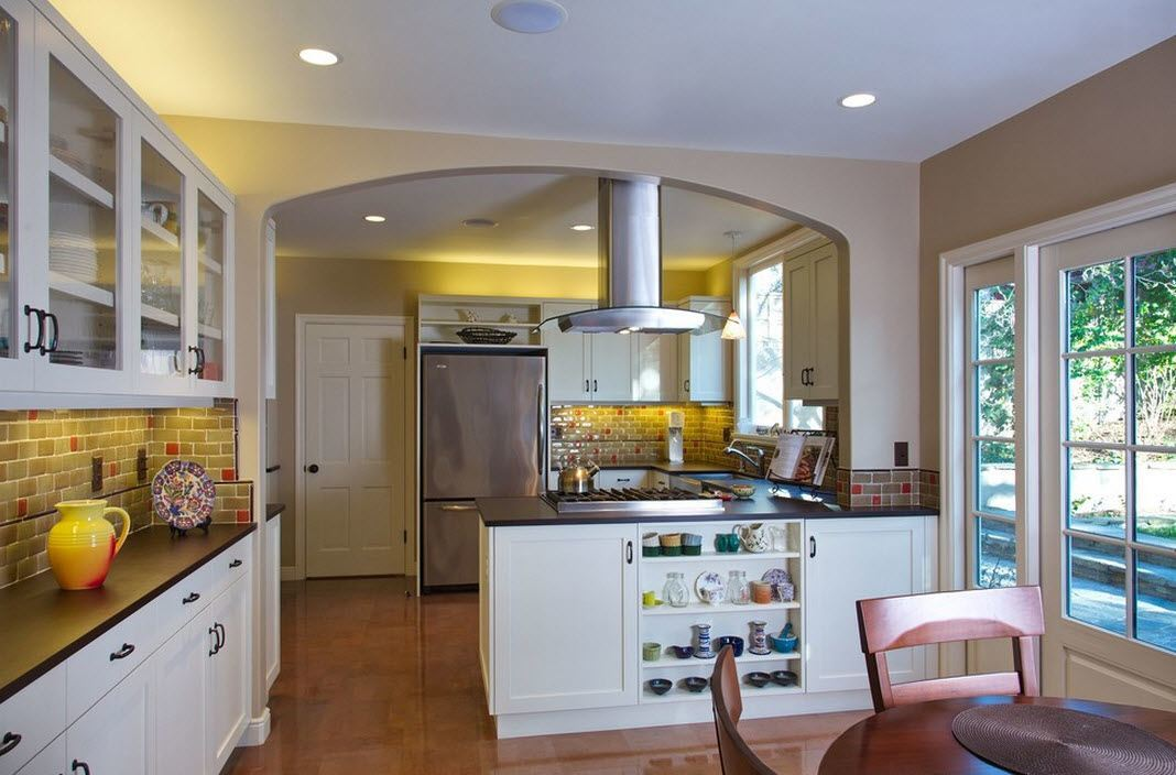 Interior Room Arches Decoration Ideas. Yellow lighting of the kitchen zone separated by nice vault