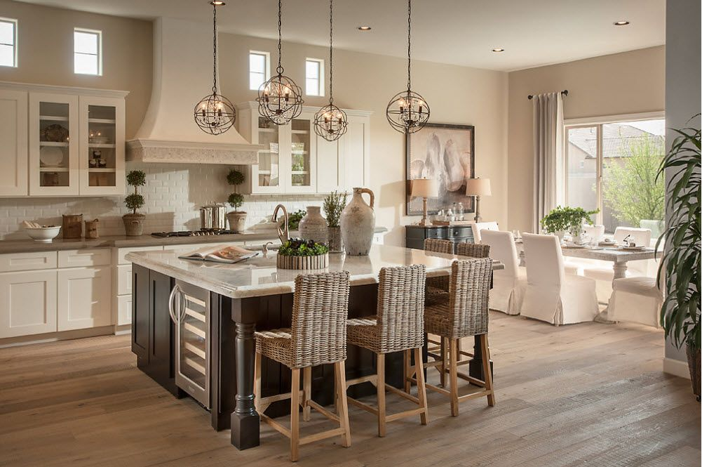Combined Kitchen and Living Room Interior Design Ideas. Wicker chairs near the wooden countertop of the island