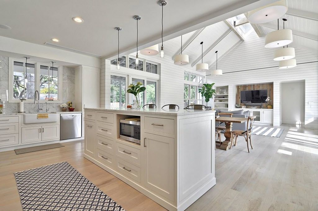 Combined Kitchen and Living Room Interior Design Ideas. high white classic island with build-in electric oven