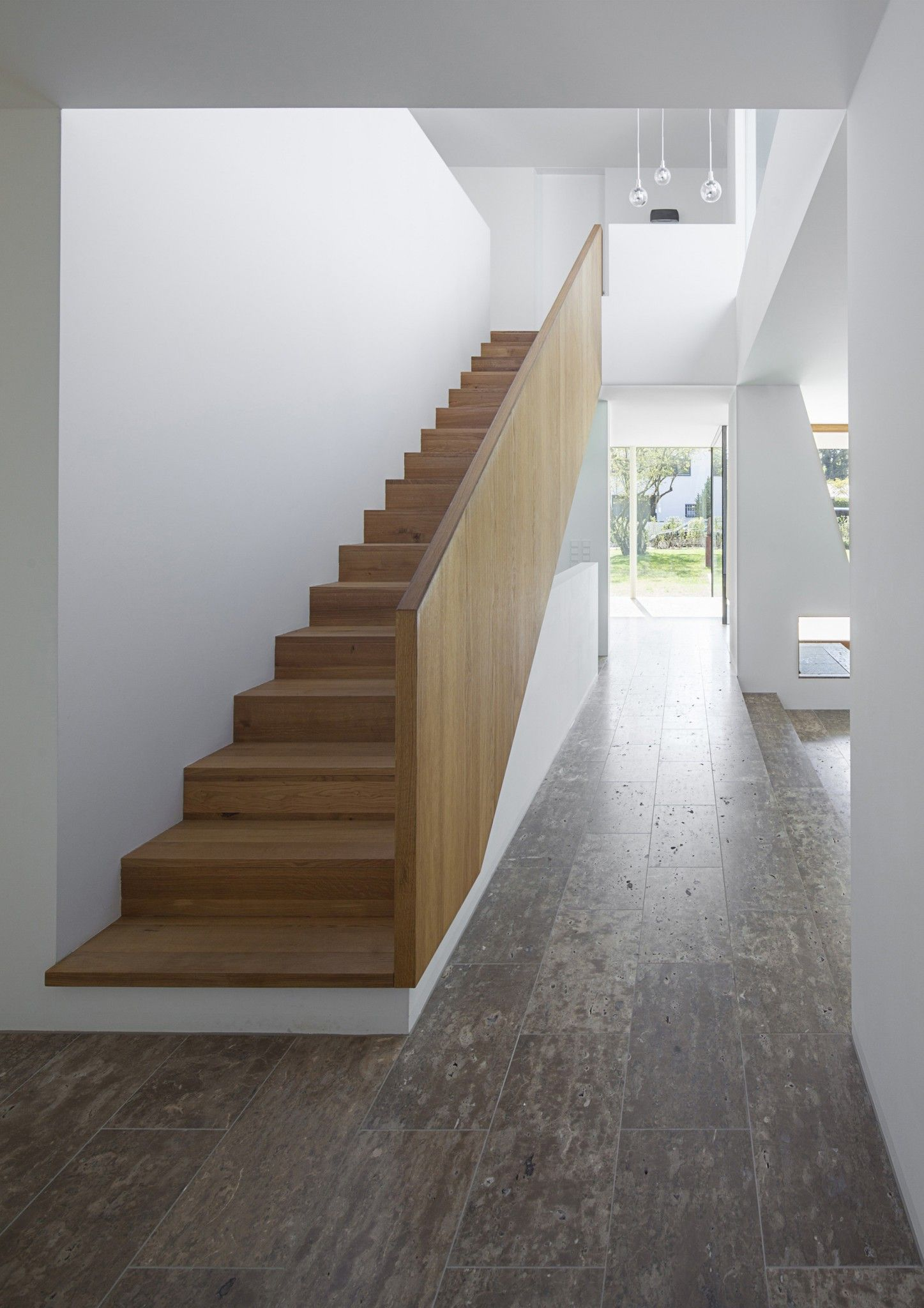 German Minimalistic House Brief Overview. Futuristic and minimalistic staircase from the front view