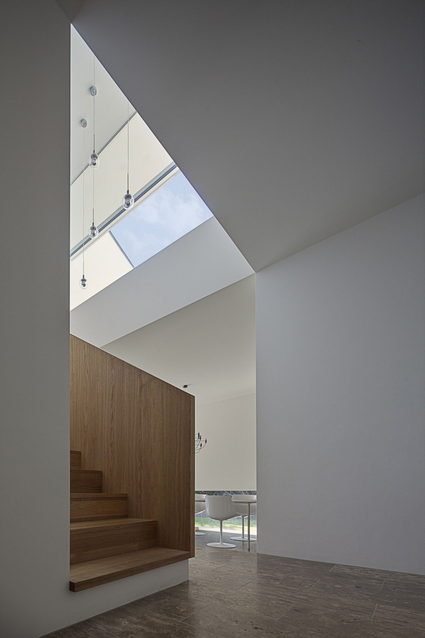 German Minimalistic House Brief Overview. Original staircase under the cloped ceiling