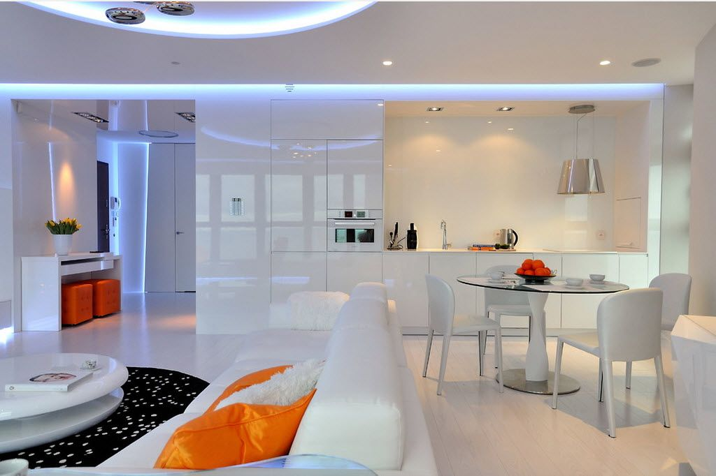 Combined Kitchen and Living Room Interior Design Ideas. White low-key but impressive hi-tech design of the combined studio