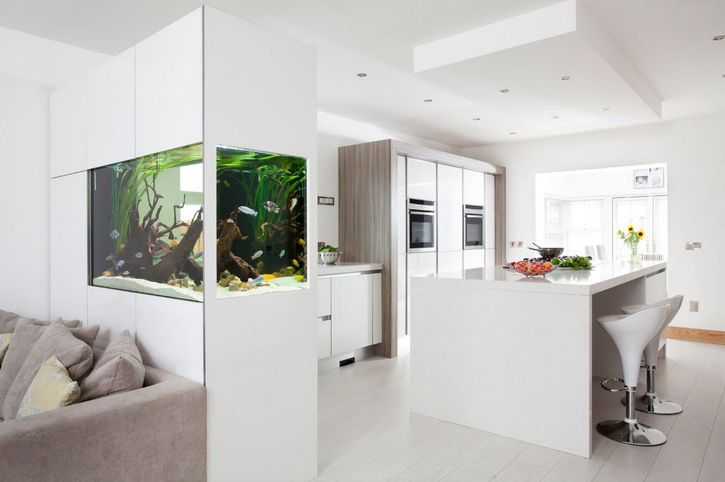 Aquarium is the focal center of the totally white interior