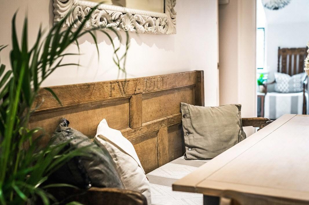 Scottish Apartment Unusual Country Interior Design. Dining sofa with an old wooden door as backrest
