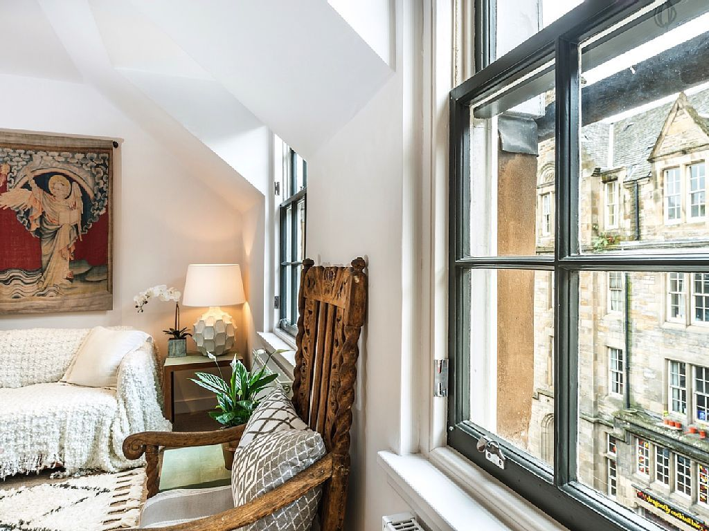 Scottish Apartment Unusual Country Interior Design. Windows And Sloping  Ceiling In The Light Atmosphere Of
