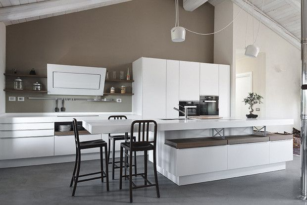 Kitchen Design Latest Trends 2016. Black chairs near the island as peculiar accents in the overall decoration