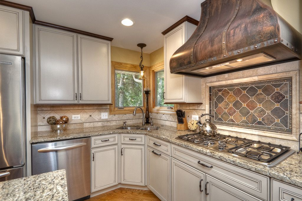 Choosing Best Kitchen Tile Ideas. Classic French Provence style with the mosaic composition under the hood dome