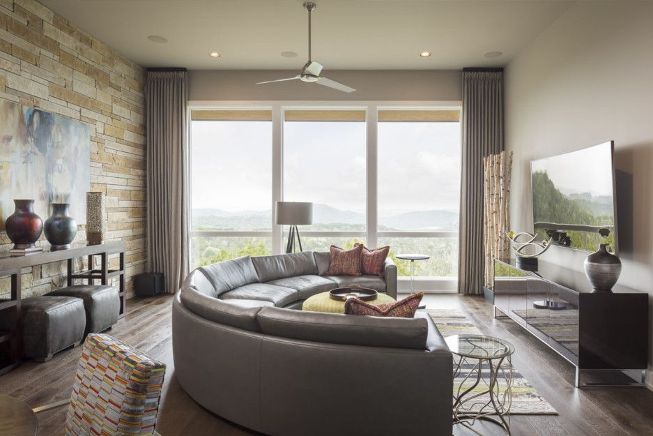 Modern Interior Design Laminate Use. Semioval leather upholstered couch in the middle of the living room resting zone