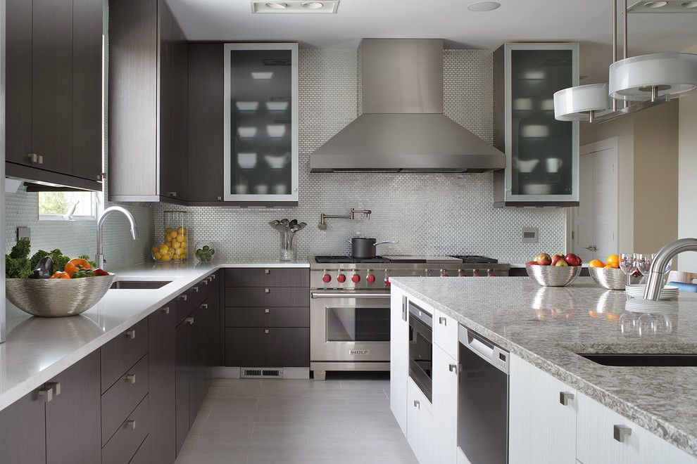 Choosing Best Kitchen Tile Ideas. Unique island layout in gray tones with all necessary appliances