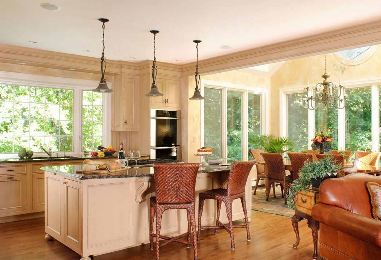 Kitchen Design Latest Trends 2016. Country style natural trimmed room with wicker chairs, island and flower decorated dining space