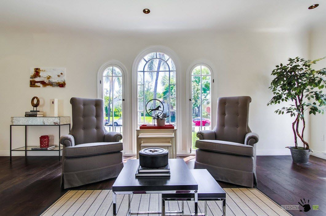 Modern Interior Design Laminate Use. Arched windows and figurines ornament the space of the house living space