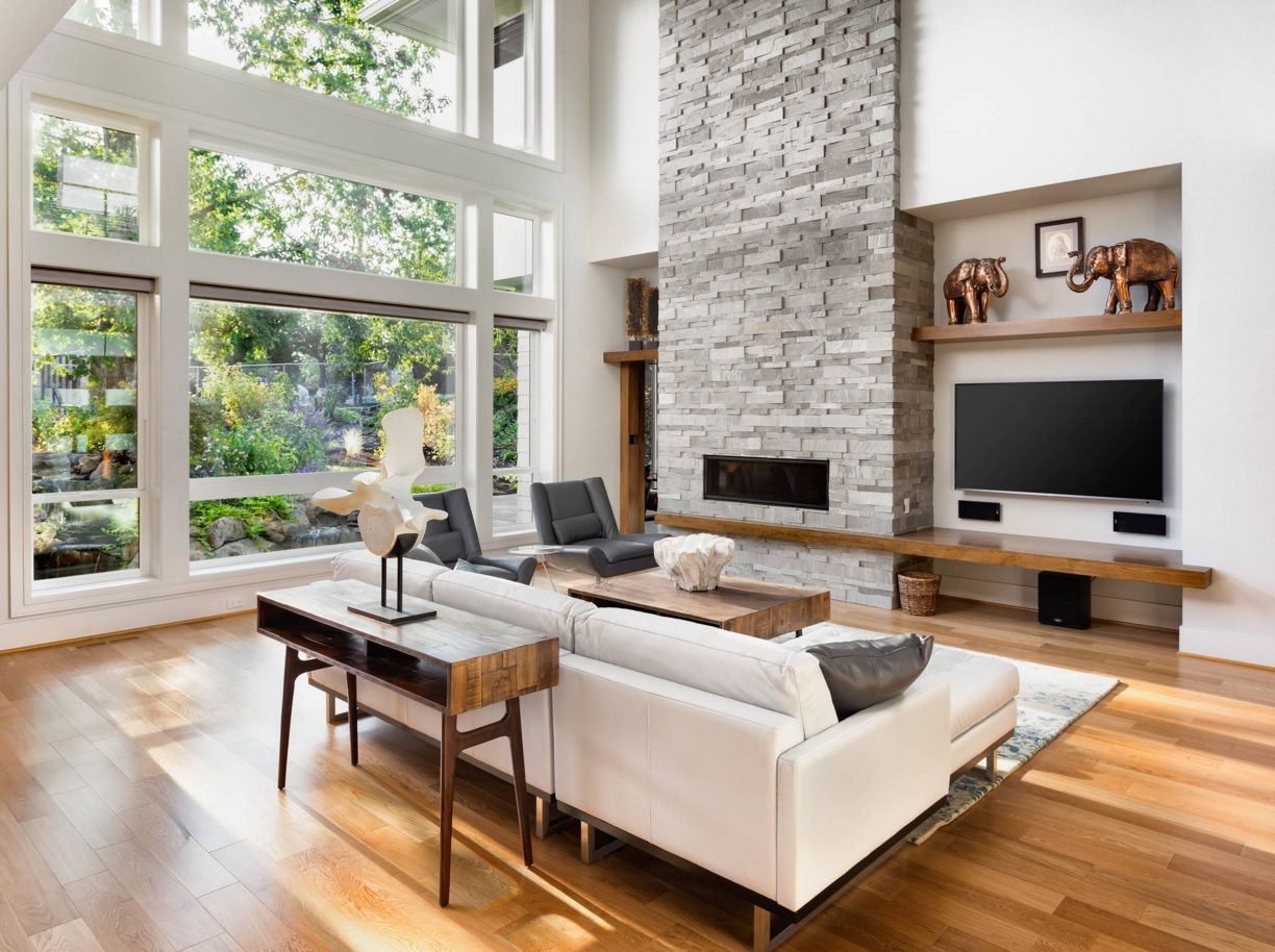 Living Room Most Topical Design Trends 2016. Laminate flooring and the contrasting stone faced wall with electric fireplace goes well with neutral color of walls and upholstered furniture
