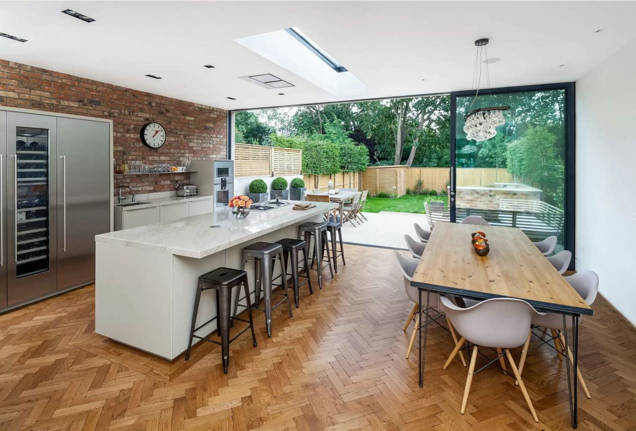 Kitchen Design Latest Trends 2016. Nice herringbone parquet in the room with brickwork wall and wide dining zone