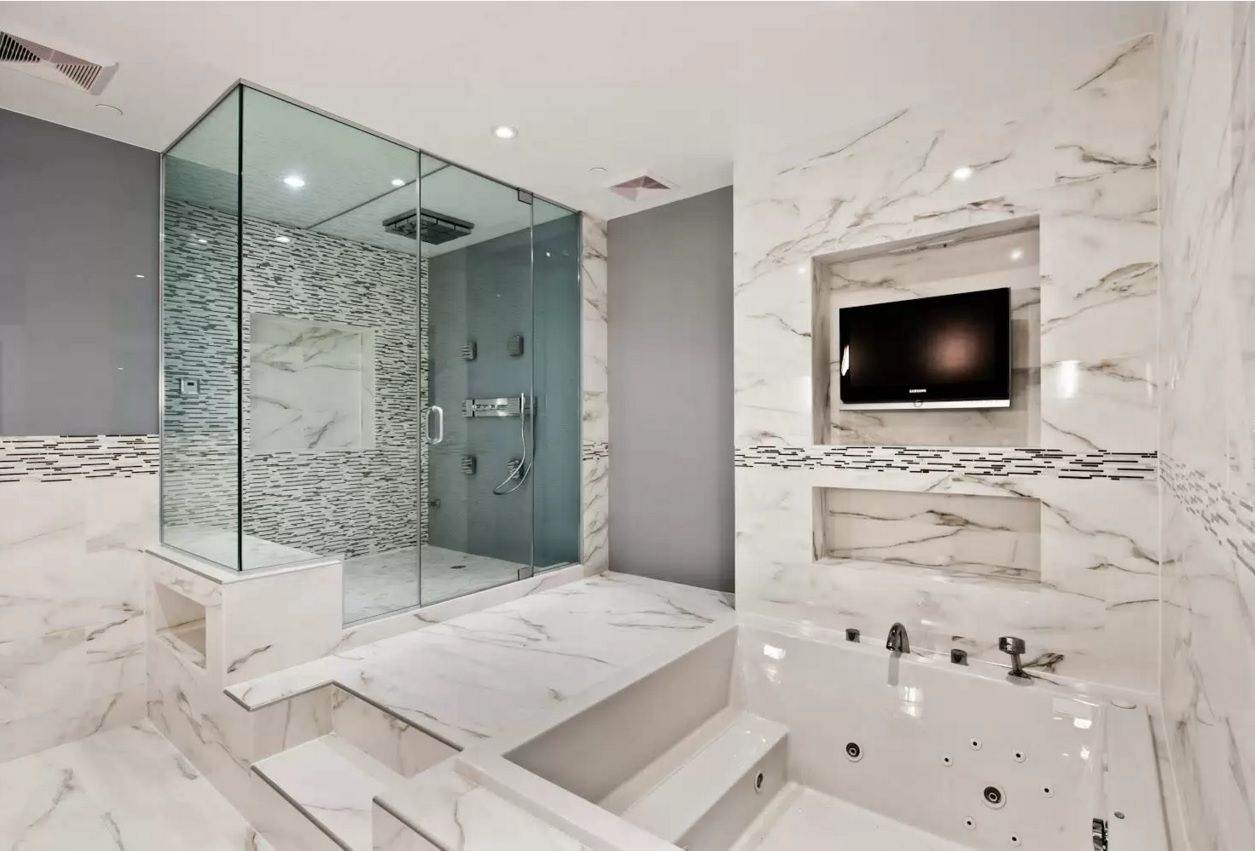 Choosing New Bathroom Design Ideas 2016. Jacuzzi and the shower cabin within one functional marble trimmed area