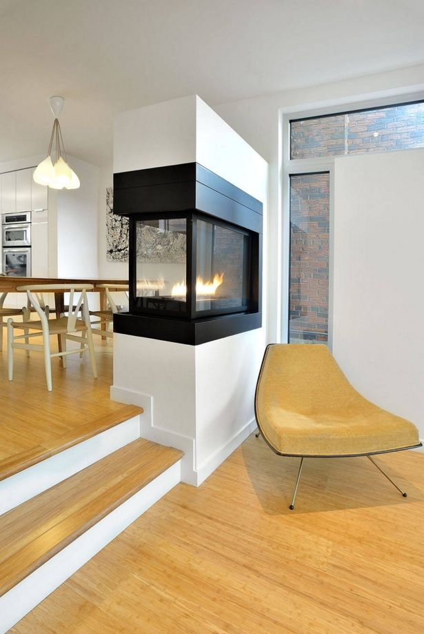 Living Room Furniture Trends 2016. Gas fireplace in the partition between zones in the studio apartment