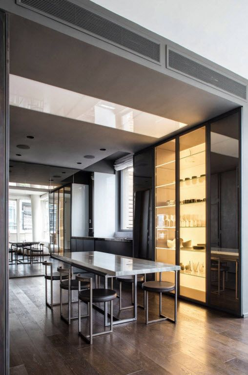 Hi-Tech Milan Apartment with Terrace Design Project. Kitchen and the dining zone all in one with intimate yellow backlighting