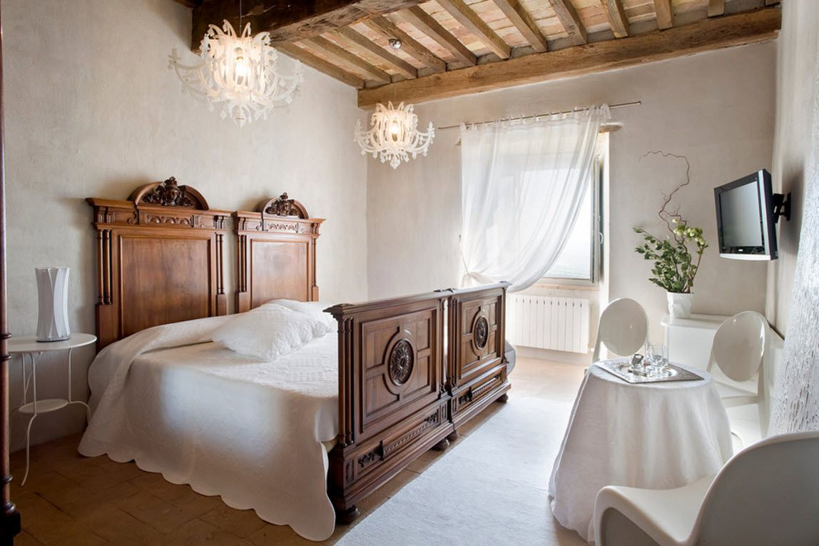 Italian Country Seashore House Design Project. Bedroom stylized in the Italian country style with royal big wooden bed and white linen