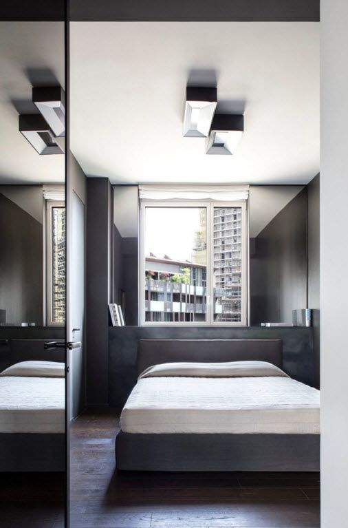 Hi-Tech Milan Apartment with Terrace Design Project. Bedroom with firm designed lighting and the cabinet for the bed dress