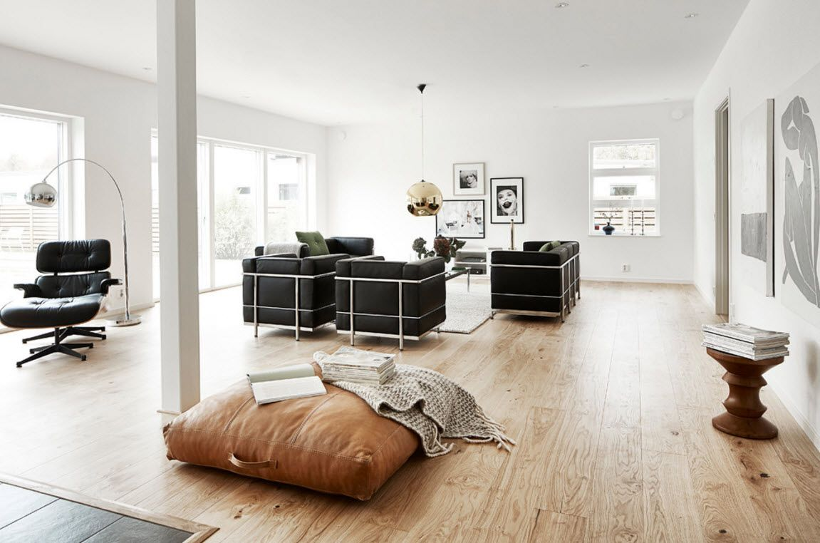 Swedish Private House Contrasting Design. Modern living room arrangement with resting and chatting zones as well as light natural materials trimming