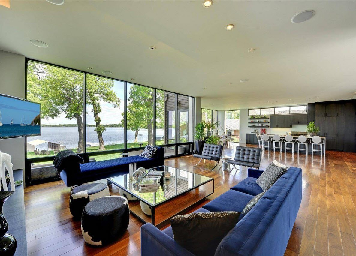 Panoramic Windows Design and Using in Modern Homes Ideas. ultra-modern appearance of the living room in the private mansion near the shore