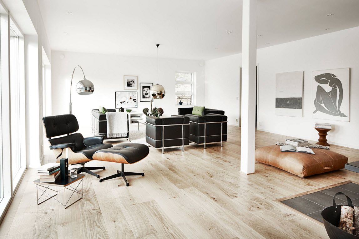 Swedish Private House Contrasting Design. Living studio with modern black folding armchair