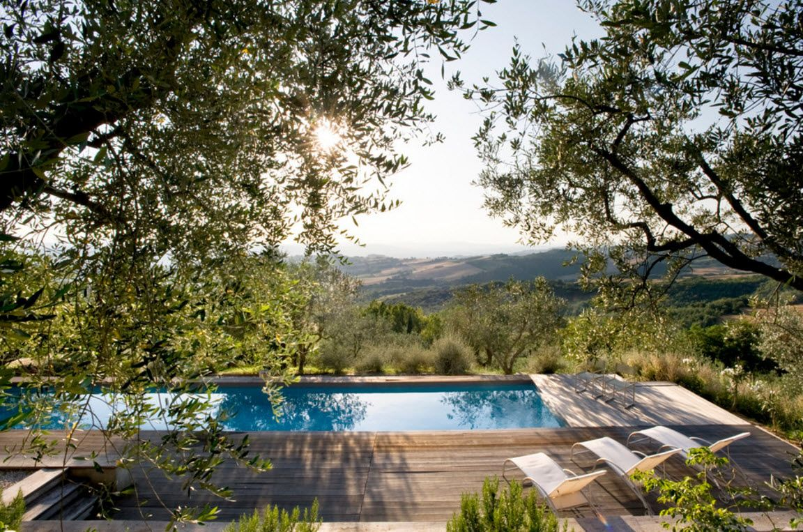 Italian Country Seashore House Design Project. Swimming pool with natural shade in the trees