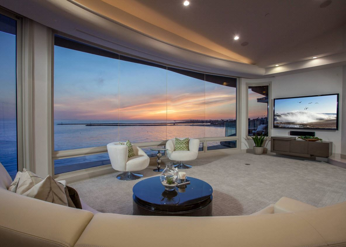 Panoramic Windows Design and Using in Modern Homes Ideas. Glass wal to the shore in the living room looks spectacular and enchanting