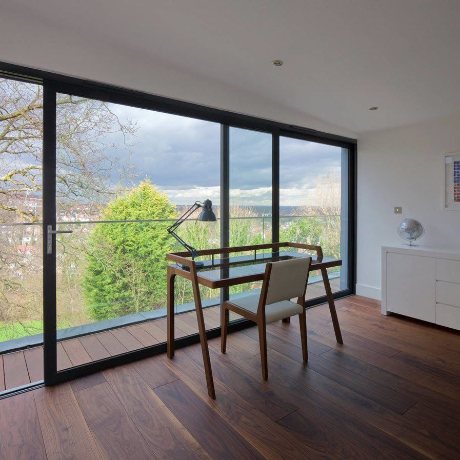 Panoramic Windows Design and Using in Modern Homes Ideas. Spellbinding home office with the glass window panel and the entrance to the terrace